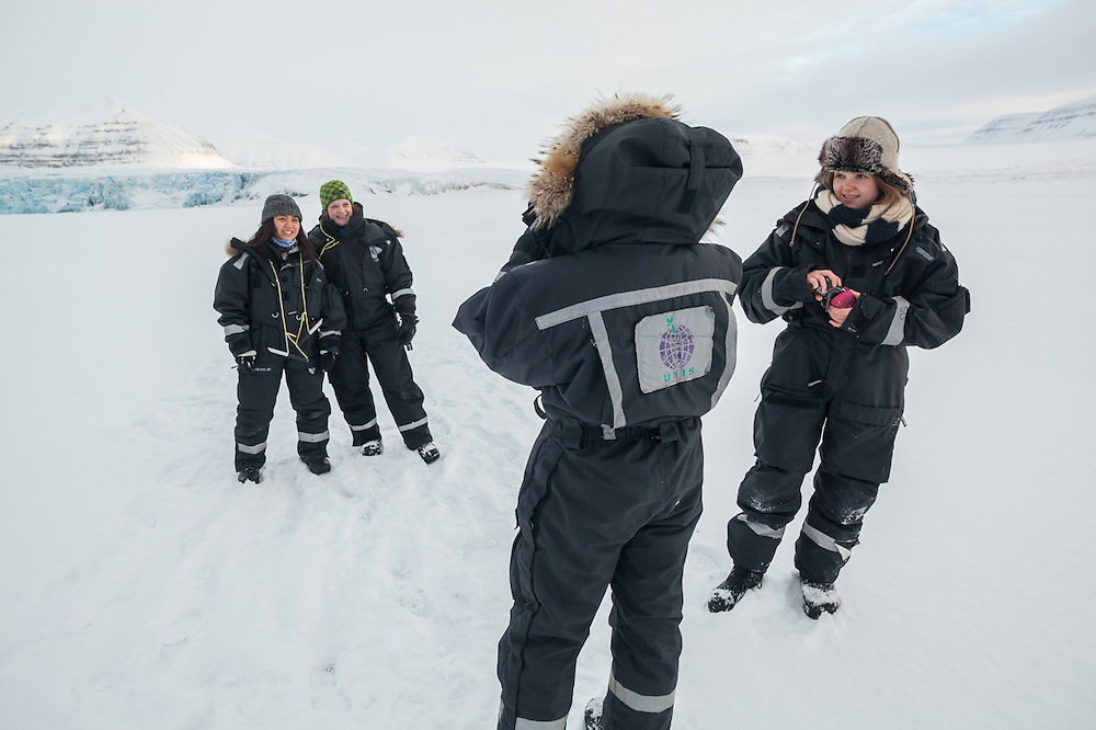 UNIS students Mei Gong (left) and Solveig Winsvold have their picture taken together on the sea ice in Templefjorden at the terminus of Tunabreen, Svalbard.