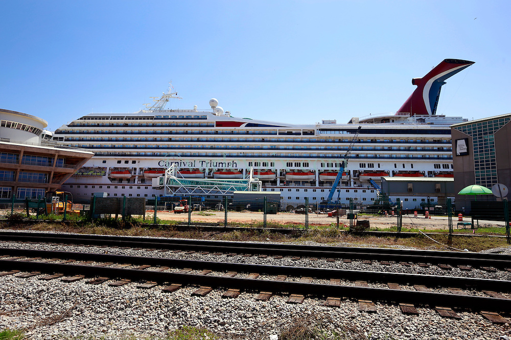 21 Apr 2013. Mobile, Alabama..The Carnival Cruise ship 'Triumph' remains in port in Alabama undergoing repairs since the beleaguered ship was towed to port in February following a fire in the Gulf of Mexico. The ship recently broke its moorings and suffered damage at port following a severe storm. Operators continue to cancel sailings as overhaul work continues apace. .Photo; Charlie Varley.
