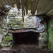 Ty Isaf, inglenook fireplace with chamfered timber lintel, Garreg Fawr, Gwynedd.