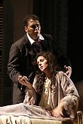 Thursday, Nov. 6th 2003 -- LA TRAVIATA -- Leah Hunt in the role of Violetta Valery, and Jorge Antonio Pita as Alfredo Germont in the death scene from Guseppi Verdi La Traviata presented by the Florida Grand Opera at the Miami-Dade County Auditorium.(El Nuevo Herald Photo/Gaston De Cardenas)