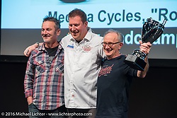 Mick O'Shea gets an award for his custom Ducati from Neil Blaber at the AMD World Championship of Custom Bike Building Award Ceremony on the stage in the custom dedicated Hall 10 at the Intermot Motorcycle Trade Fair. Cologne, Germany. Sunday October 9, 2016. Photography ©2016 Michael Lichter.