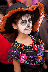 North America, Mexico, Oaxaca Province, Oaxaca, girl in costume for Day of the Dead (Dias de los Muertos) celebration