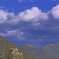 CHINA, TIBET. Fortress-like Yumbu Lakang, the oldest castle remaining in Tibet, atop a hill near Tsedang.