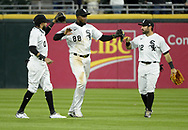 CHICAGO - APRIL 23:  Billy Hamilton #0 (L), Luis Robert #88 and Adam Eaton #12 (R) of the Chicago White Sox celebrate after the game against the Texas Rangers on April 23, 2021 at Guaranteed Rate Field in Chicago, Illinois.  (Photo by Ron Vesely) Subject:  Billy Hamilton; Luis Robert; Adam Eaton