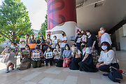 Mothers who have had their children abducted by husbands show support on day seven of Frenchman, Vincent Fichot's (standing centre) hunger strike outside Sendagaya Station, Tokyo, Japan. Saturday July 17th 2021. Vincent Fichot has not seen his two children since they were abducted by his wife in 2018. He started a hunger strike to put pressure on French President, Emmanuel Macron, who will be attending the 2020 Tokyo Olympic opening ceremony, to raise the issue further with the Japanese government.