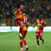 Galatasaray's players (L-R) Emre Colak, Umut Bulut, Emmanuel Eboue celebrating his goal and Kasimpasa's goalkeeper Andreas Isaksson (L) during their Turkish Super League soccer match Galatasaray between Kasimpasa at the TT Arena at Seyrantepe in Istanbul Turkey on Monday 20 August 2012. Photo by TURKPIX