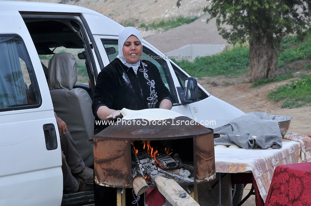 Druze women Baking pita outdoors