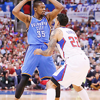 11 May 2014: Oklahoma City Thunder forward Kevin Durant (35) looks to pass over Los Angeles Clippers forward Matt Barnes (22) during the Los Angeles Clippers 101-99 victory over the Oklahoma City Thunder, during Game Four of the Western Conference Semifinals of the NBA Playoffs, at the Staples Center, Los Angeles, California, USA.