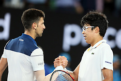 MELBOURNE, Jan. 22, 2018  Chung Hyeon (R) of South Korea and Novak Djokovic of Serbia greet each other after the men's singles fourth round match at Australian Open 2018 in Melbourne, Australia, Jan. 22, 2018. Chung Hyeon won by 3-0. (Credit Image: © Li Peng/Xinhua via ZUMA Wire)