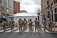 """Soldiers in Washington DCat a checkpoint in Washington D.C.'s """"Green Zone"""" deployed to secure Biden's inuguration after the insurgency on Jan. 6, 2021."""
