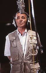 Undated file photo of Charles Aznavour in a recording studio. French singer and songwriter Charles Aznavour has died at 94 after a career lasting more than 80 years, The star died at one of his homes in the south east of France. The performer, born to Armenian immigrants, sold more than 180 million records and featured in over 60 films. Photo by Pascal Baril/ABACAPRESS.COM