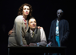 """© Licensed to London News Pictures. 17/12/2012. London, England. L-R: Susan Lynch as Margarita, Paul Rhys as The Master and Richard Katz as Bezdomny. Complicite/Simon McBurney return to the Barbican with the play """"The Master and Margarita"""" by Mikhail Bulgakov from 14 December 2012 - 19 January 2013. Directed by Simon McBurney with Tim McMullan as Pontius Pilate, Susan Lynch as Margarita, Richard Katz as Ivan Nikolayich Bezdomny and Paul Rhys as The Master. Photo credit: Bettina Strenske/LNP"""