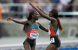 (L-R) Vivian Cheruiyot of Kenya and Sylvia Jebiwott Kibet of Kenya celebrate after the women's 5000 Metres Final during day eight of the 12th IAAF World Athletics Championships at the Olympic Stadium on August 22, 2009 in Berlin, Germany. (Photo by Vid Ponikvar / Sportida)