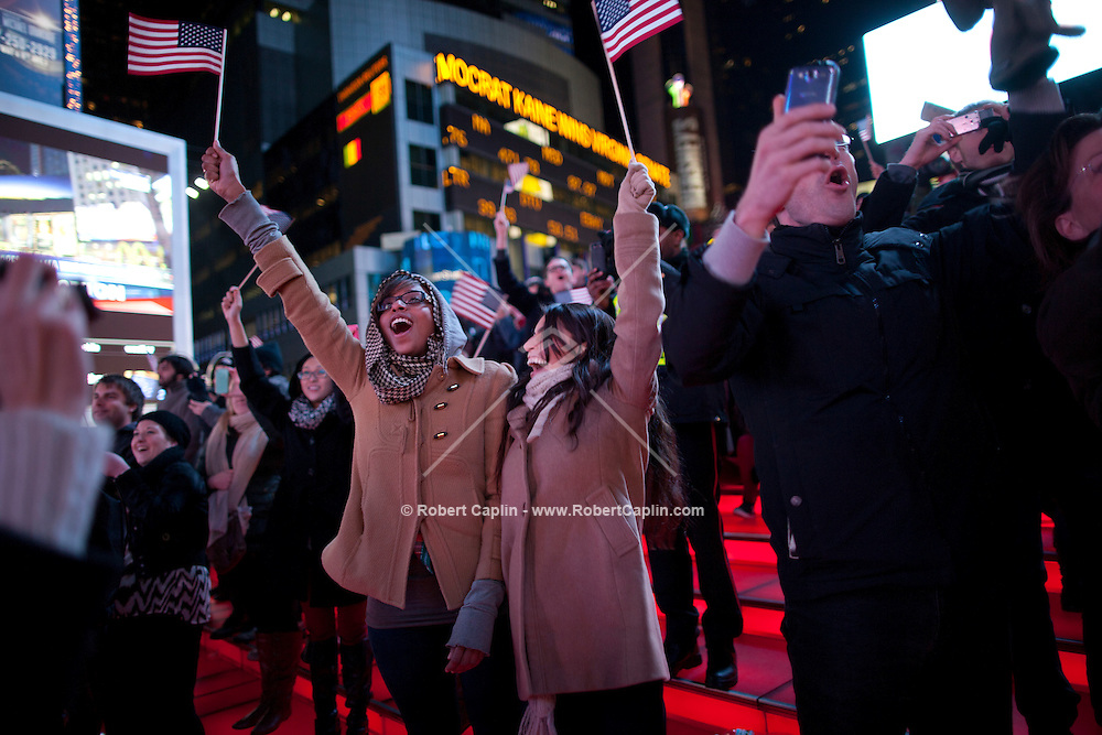 .Venessa Dobney, left, and Karen Jimenez, right celebrate as they watch election results come in for President Barack Obama in Times Square on election night. President Obama defeated Mitt Romney to win the 2012 Presidential Election.  ..Photo by Robert Caplin......