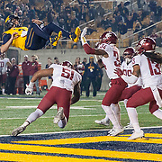 Oct 13 2017 - Berkeley  CA, U.S.A. California quarterback Ross Bowers (3) game stats 21-38 259 yards and 1 touchdown goes air-borne to score a touchdown during the NCAA Football game between Washington State Cougars and the California Golden Bears 37-3 win at California Memorial Stadium.  Thurman James / CSM