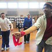 January 17, 2009 -- BATH, Maine. Zumba teacher, Tony Garreton, dances a lead role in front of a class of students on Saturday afternoon at Huse School in Bath. Garreton, a native of Peru, teaches the dance as an aerobic exercise class in many places through the midcoast area. He volunteered to give a lesson as part of the bi-weekly, free education series called Adventures at Huse. ..For the next Adventures at Huse event, check the calendar on page   XXXXXXX   . ...Founder of the Zumba dance will be coming to Portland's Eastland Park Hotel for a show and dance next week. For more information on Zumba visit:  www.ZumbaMe.com. Photo by Roger S. Duncan.