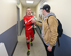 WREXHAM, WALES - Monday, May 2, 2016: The New Saints' captain and goalkeeper Paul Harrison walks back to the dressing room with the trophy after the 2-0 victory over Airbus UK Broughton during the 129th Welsh Cup Final at the Racecourse Ground. (Pic by David Rawcliffe/Propaganda)