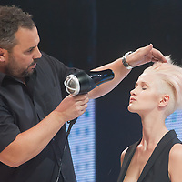 Model presents hair creation during the Essential Looks hair show in Budapest, Hungary on July 10, 2011. ATTILA VOLGYI