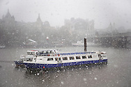 Boat on the River Thames London with large snow flakes falling - winter scene .<br /> <br /> Visit our ENGLAND PHOTO COLLECTIONS for more photos to download or buy as wall art prints https://funkystock.photoshelter.com/gallery-collection/Pictures-Images-of-England-Photos-of-English-Historic-Landmark-Sites/C0000SnAAiGINuEQ