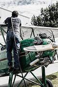 Man refueling Waco RNF at WAAAM.