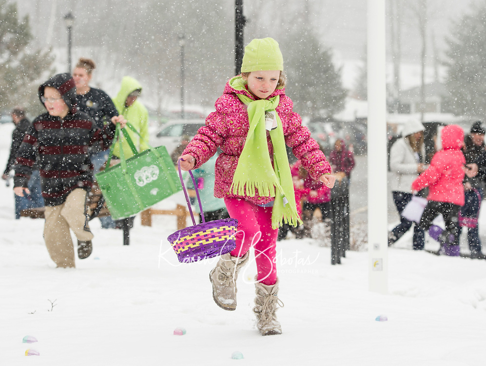 """Jazmine LeClerc steps carefully through the Easter Egg """"hunt zone"""" at the Weirs Community Park on Saturday morning.  (Karen Bobotas/for the Laconia Daily Sun)"""