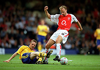 Dennis Bergkamp (Arsenal) Brett Ormerod (Southampton).  Arsenal v Southampton FA Cup Final 2003 @ Cardiff Arms Park. 17/5/2003. Credit : Colorsport/Andrew Cowie.