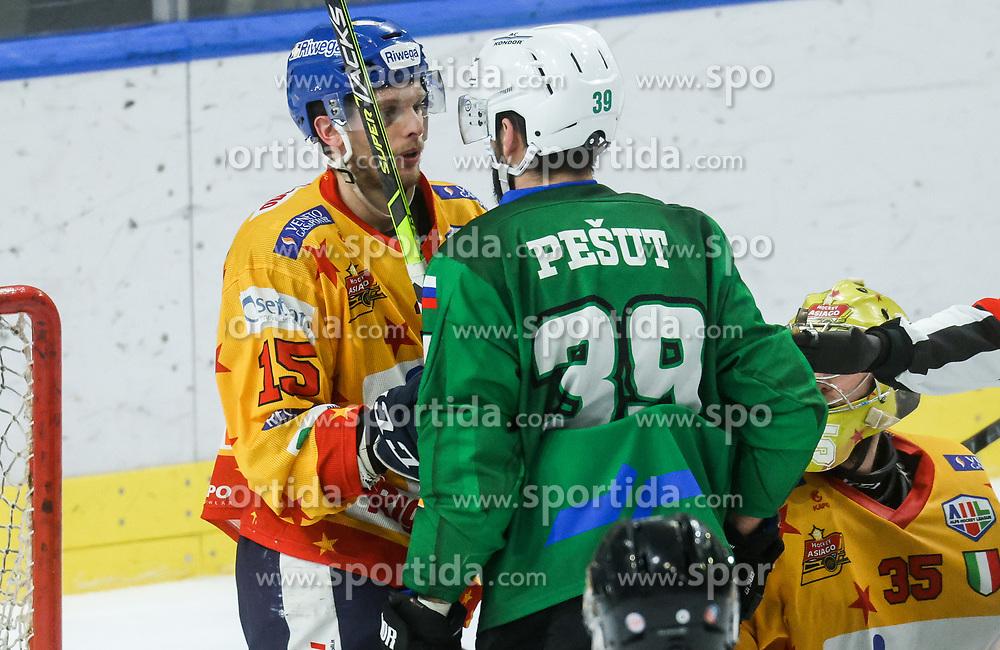 Miglioranzi Enrico of Asiago and Pesut Ziga of HK SZ Olimpija during first leg Ice Hockey game between HK SZ Olimpija Ljubljana and Asiago Hockey in Final of Alps Hockey League 2020/21, on April 20, 2021 in Hala Tivoli, Ljubljana, Slovenia. Photo by Vid Ponikvar / Sportida