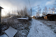 Footprints in a dusting of new snow on a back alley pathway in Nenana, Alaska