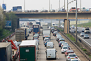 Heavy weight of traffic travelling on M1 motorway in Hertfordshire, United Kingdom