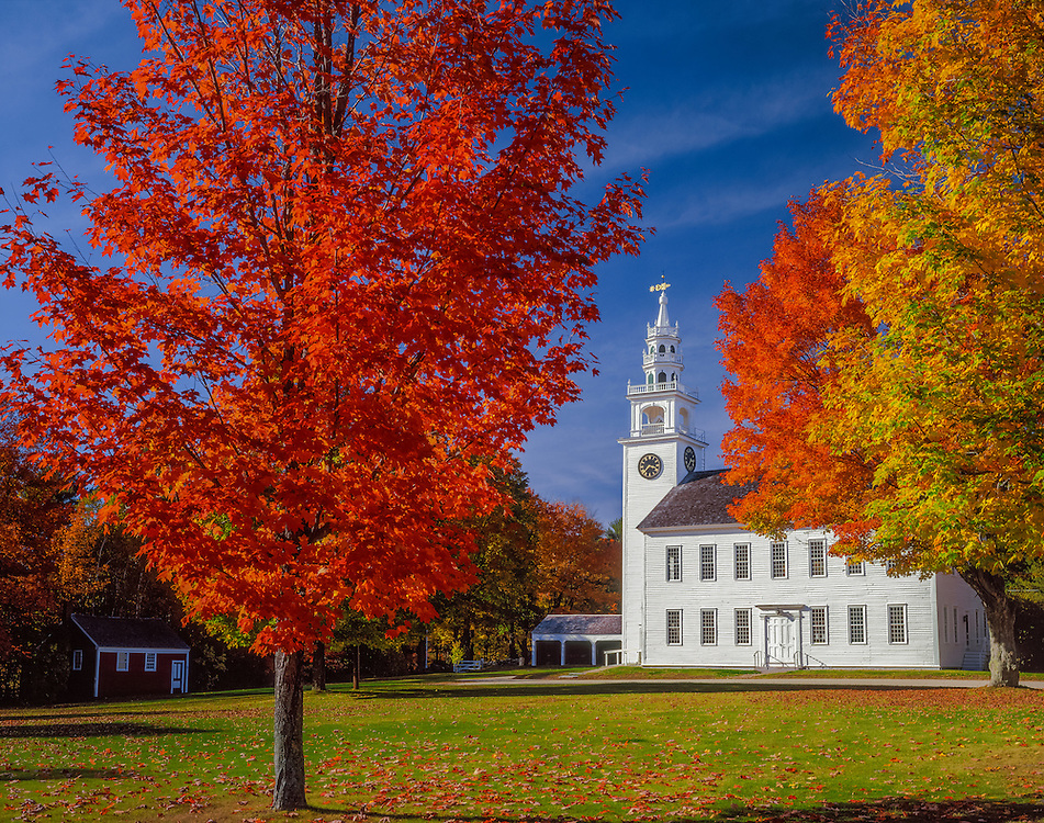 Meeting House & carriage sheds framed by maple trees in fall color, Jaffrey Center, NH