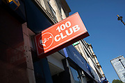 Sign for the famous 100 Club music venue in London, England, United Kingdom. The 100 Club is a live music venue located at 100 Oxford Street, which has been hosting live music since 24 October 1942. It was originally called the Feldman Swing Club, but changed its name when the father of the current owner took over in 1964.