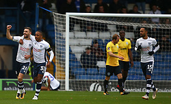 Bury's Jay O'Shea (left) celebrates scoring his side's first goal of the game