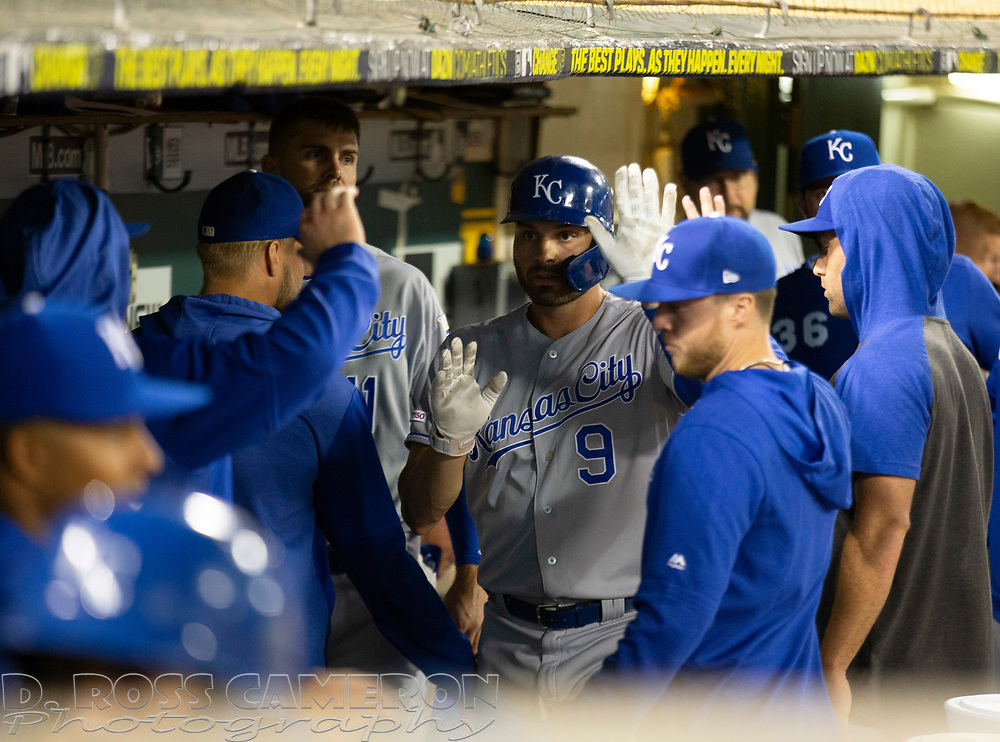Sep 17, 2019; Oakland, CA, USA; Kansas City Royals Ryan McBroom (9) gets high fives from his teammates after scoring on a sacrifice fly by Nick Dini during the fifth inning of a baseball game against the Oakland Athletics at Oakland Coliseum. Mandatory Credit: D. Ross Cameron-USA TODAY Sports