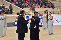 October 31, 2017 - Athens, Attiki, Greece - President of the Hellenic Olympic Committee Spyros Capralos (left) and President of the Organising Committee for the XXIII Winter Olympics Games 'PYEONGCHANG 2018' Lee Hee Beom (right), who is holding the Olympic Flame. The Handover Ceremony of the Olympic Flame for Winter Games PYEONGCHANG 2018, took place today in Panathenaic Stadium in the presence of the President of Hellenic Republic Prokopis Pavlopoulos. (Credit Image: © Dimitrios Karvountzis/Pacific Press via ZUMA Wire)