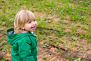 Happy Young blond female toddler of two