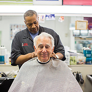 Don Behringer (seated) among the many regulars who come to see Ron Raeford when they need a haircut.