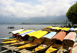July 5, 2018 - Dal Lake, Jammu And Kashmir, India - On a cloudy day boats are moored in Dal Lake in Srinagar, the summer capital of Indian administered Kashmir, India, on July 5, 2018. (Credit Image: © Masrat Jan/NurPhoto via ZUMA Press)