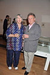 Artist GLEN BAXTER and his wife CAROL BAXTER at a private view of work by the late Rory McEwen - The Colours of Reality, held at the Shirley Sherwood Gallery, Kew Gardens, London on 20th May 2013.