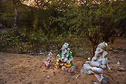Damaged effigies of Ganash line the road leading to a temple dedicated to the Hindu monkey god Hanuman on 22nd February 2018 in Jaipur, Rajasthan, India. This is one of the most famous Monkey God temples because a tribe of his present day monkey relatives resides there.