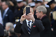 A guest of President Donald Trump takes a camera phone photo of the media during the 68th President Inaugural Ceremony on Capitol Hill January 20, 2017 in Washington, DC.
