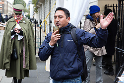 London, UK. 30th October, 2018. Henry Chango-Lopez, President of the Independent Workers of Great Britain (IWGB) trade union, addresses members and supporters marching together with other precarious workers from the offices of Transport for London to the University of London via the Court of Appeal in support of Uber drivers who are seeking employment rights. The Court of Appeal will today hear an appeal by Uber against a ruling that its drivers are employees rather than self-employed workers.