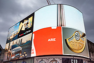 Illuminated advertising at Piccadilly Circus in London, UK. Piccadilly Circus was surrounded by illuminated advertising hoardings on buildings, starting in 1908 with a Perrier sign,[12] but only one building now carries them, the one in the northwestern corner between Shaftesbury Avenue and Glasshouse Street.