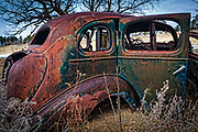 Wreck of an old Pontiac car from the 30s or 40s