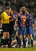 Photo. Jed Wee.Digitalsport<br /> Glasgow Celtic v Barcelona, UEFA Cup, Celtic Park, Glasgow. 11/03/2004.<br /> Barcelona's Javier Saviola (7) tries to plead his case with referee Wolfgang Stark after being shown the red card.