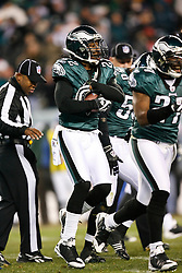 Philadelphia Eagles cornerback Asante Samuel #22 holds onto the ball and is congratulated by teamates after he intercepted a pass during the NFL game between the San Francisco 49ers and the Philadelphia Eagles on December 20th 2009.  At Lincoln Financial Field in Philadelphia, Pennsylvania. (Photo By Brian Garfinkel)