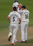 Scott Borthwick (16) and Paul Collingwood (5) celebrate with bowler Chris Rushworth (Durham County Cricket Club) after taking the wicket of Laurie Evans (Warwickshire County Cricket Club) during the LV County Championship Div 1 match between Durham County Cricket Club and Warwickshire County Cricket Club at the Emirates Durham ICG Ground, Chester-le-Street, United Kingdom on 15 July 2015. Photo by George Ledger.
