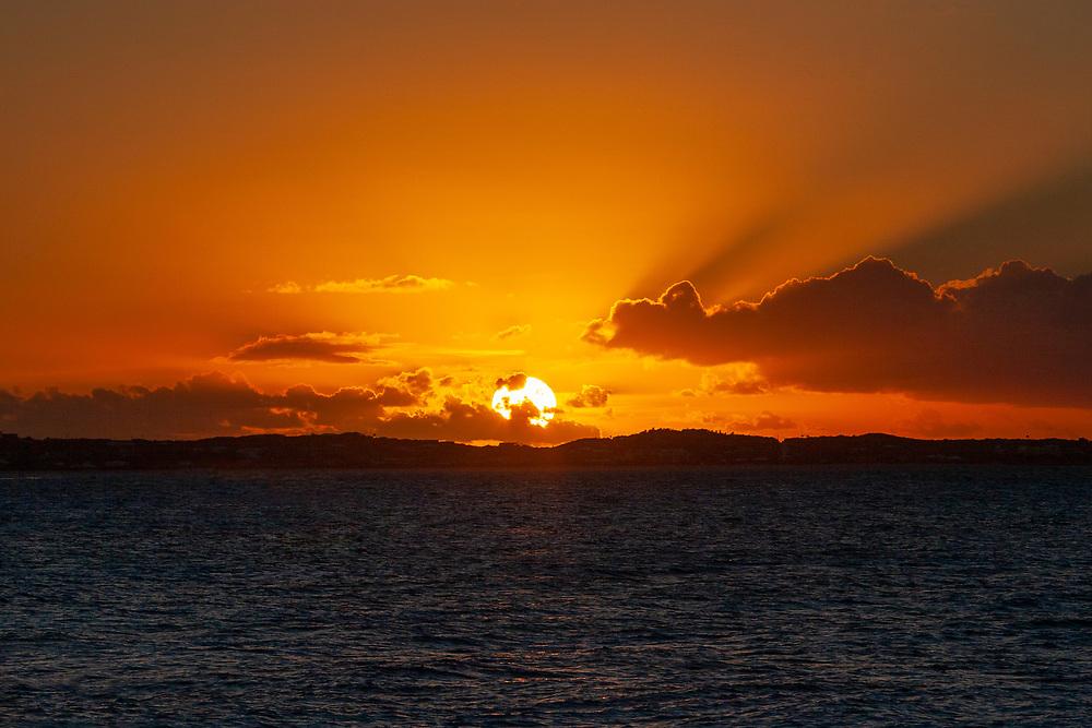 Golden sun setting over the Caribbean sea
