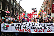 In a march organised by the Peoples Assembly, demonstrators protest  against austerity measures affecting health, education and employment, brought in by the Tory Government headed by Prime Minister David Cameron on April 16th 2016 in London, United Kingdom. Calls for Cameron's resignation followed revelations in the 'Panama Papers'. A banner at the front of the demo says We demand health, home, jobs and education. Cameron must go.