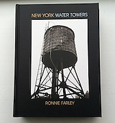 """ISBN 978-0-9898856-4-5<br /> <br /> New York Water Towers<br /> by Ronnie Farley<br /> <br /> 6 1/4"""" x 8 1/4"""" hardcover<br /> 42 black and white, 40 color photographs<br /> <br /> $25.00 +5.00 p & h<br /> Paypal. credit card or check to:<br /> <br /> Ronnie Farley<br /> P.O. Box 423, Beacon, NY 12508"""