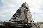 old concrete cone by a gate
